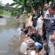 Pemasangan Papan Nama dan Pelepasan ribuan benih ikan di sungai Ajung